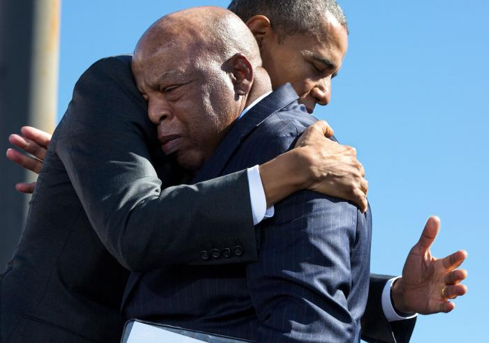 President Barack Obama hugs Rep. John Lewis, D-Ga., after his introduction during the event to commemorate the 50th Anniversary of Bloody Sunday and the Selma to Montgomery civil rights marches, at the Edmund Pettus Bridge in Selma, Ala., March 7, 2015.