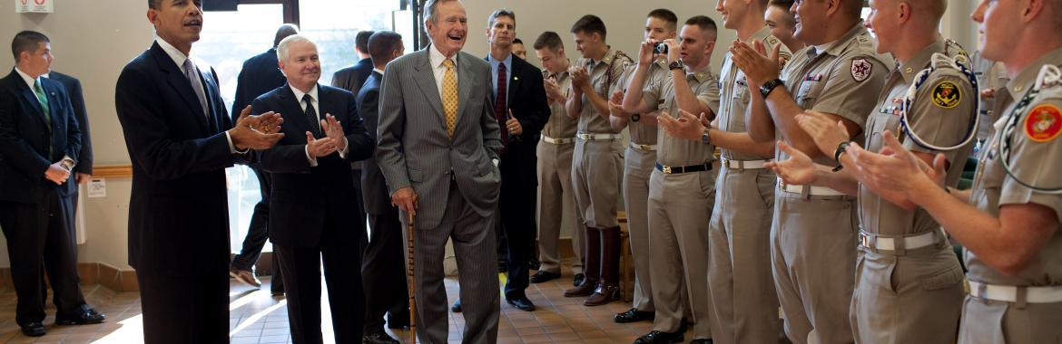 President Barack Obama, former President George H. W. Bush and Defense Secretary Robert Gates greet Marine Corps cadets in the Marine Corps Mess Hall at Texas A&M University, in College Station, Texas, Oct. 16, 2009