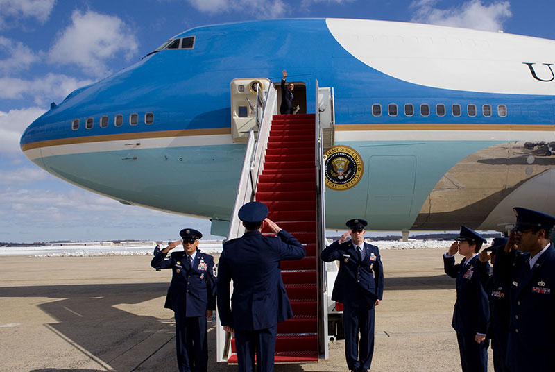President Barack Obama is saluted by Air Force members as he waves from Air Force One prior to departing from Andrews Air Force Base en route to Denver, Colo., Feb. 18, 2010. (P021810PS-0464)