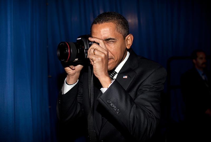 President Barack Obama takes aim with a photographer's camera backstage prior to remarks about providing mortgage payment relief for responsible homeowners at Dobson High School, Mesa, Arizona, February 18, 2009. (P021809PS-0069)